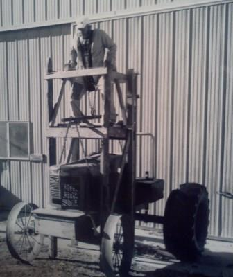 al spings and his tractor lift usawa